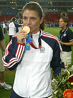 26 August 2004:  Mia Hamm with her gold medal after defeating Brazil , 2-1 in overtime at Karaiskakis Stadium in Athens, Greece.  Credit: Michael Pimentel / ISI.