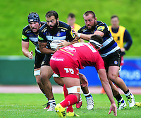 Kane Palma-Newport of Bath Rugby takes on the Scarlets defence. Pre-season friendly match, between the Scarlets and Bath Rugby on August 20, 2016 at Eirias Park in Colwyn Bay, Wales. Photo by: Patrick Khachfe / Onside Images