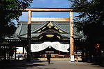 A man bows in front of the main hall of Yasukuni Shrine in Tokyo, Japan. very year on August 15, the day Japan officially surrendered in WWII, tens of thousands of Japanese visit the controversial shrine to pay their respects to the 2.46 million war dead enshrined there, the majority of which are soldiers and others killed in WWII and including 14 Class A convicted war criminals, such as Japan's war-time prime minister Hideki Tojo. Each year speculation escalates as to whether the country's political leaders will visit the shrine, the last to do so being Junichiro Koizumi in 2005. Nationalism in Japan is reportedly on the rise, while sentiment against the nation by countries that suffered from Japan's wartime brutality, such as China, has been further aggravated by Japan's insistence on glossing over its wartime atrocities in school text books..Photographer:Robert Gilhooly..Photographer:Robert Gilhooly