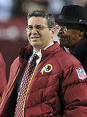 Landover, MD - December 27, 2009 -- Washington Redskins owner Daniel Snyder watches his team warm-up prior to his team's game against the Dallas Cowboys at FedEx Field in Landover, Maryland on Sunday, December 27, 2009.  Former CNN anchor Bernard Shaw is at the right of the frame..Credit: Ron Sachs / CNP.(RESTRICTION: NO New York or New Jersey Newspapers or newspapers within a 75 mile radius of New York City)
