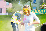Eimear Curran gets a little too much paint in the eyes at the Colour Scramble in Cahersiveen on Saturday