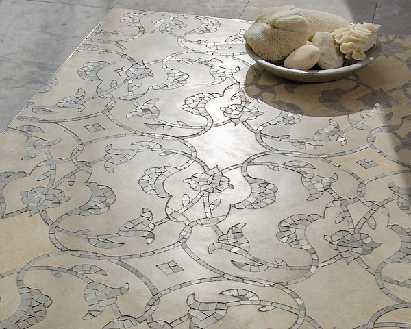 Yasmine, a waterjet and hand-cut stone mosaic, shown in honed Saint Vincent and honed Palomar.