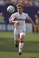 D.C. United's Bobby Convey chases down a bull. D. C. United was defeated by the NY/NJ MetroStars 3 to 2 during the MetroStars home opener at Giant's Stadium, East Rutherford, NJ, on April 17, 2004.