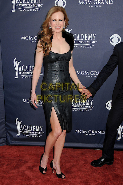 NICOLE KIDMAN.46th Annual Academy of Country Music Awards - Arrivals held at the MGM Grand Garden Arena, Las Vegas, Nevada, USA..April 3rd, 2011.full length dress slit split holding hands  black leather fur cleavage smiling.CAP/ADM/BP.©Byron Purvis/AdMedia/Capital Pictures.