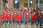 CHEERFUL: Killarney children enjoying their first day at school in Mrs Flanagan's and Mrs Counihan's classes at Holy Cross National School, Killarney, on Monday.