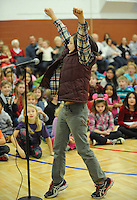 NWA Media/ANDY SHUPE - Aiden Kelly, 10, a fifth-grader at Washington Elementary School in Fayetteville, reacts to winning the school's annual spelling bee Friday, Dec. 19, 2014, in the school's gymnasium. Aiden will represent the school in the county spelling bee in January.