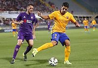 Calcio: amichevole Fiorentina vs Barcellona. Firenze, stadio Artemio Franchi, 2 agosto 2015.<br /> FC Barcelona's Luis Suarez, right, is chased by Fiorentina's Manuel Pasqual during the friendly match between Fiorentina and FC Barcelona at Florence's Artemio Franchi stadium, 2 August 2015.<br /> UPDATE IMAGES PRESS/Riccardo De Luca