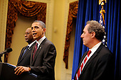 United States President Barack Obama makes a statement to the press regarding the US-Korea Trade Agreement, as US Trade Representative Ron Kirk looks on from left, and National Security Advisor Mike Froman looks on from right, in the Old Executive Office Building on Saturday, December 4, 2010, in Washington, DC.  .Credit: Leslie E. Kossoff - Pool via CNP