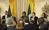 Washington, DC - March 17, 2009 -- (L to R) United States President Barack Obama, First Lady Michelle Obama, the Taoiseach of Ireland Brian Cowen and his wife Mary Molloy, take part in the annual St. Patrick's Day reception in the East Room of the White House in Washington, DC, USA on Tuesday, 17 March 2009. Obama is celebrating his first St. Patrick's Day as President..Credit: Matthew Cavanaugh - Pool via CNP