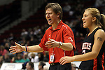 03/10/11--Oregon City head coach Kurt Guelsdorf greets his team during a timeout in the quarterfinals of girls 6A championship at the Rose Garden in Portland, Or. The Pioneers advanced to the semifinals with a score of 66-36...Photo by Jaime Valdez........................................