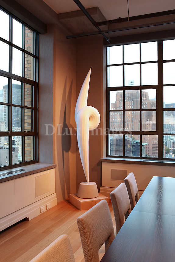 The loft is in Tribeca in New York and has views of the Hudson River to the west, the financial district to the south and east towards the East River.  The building is commercial/residential with the bottom 6 floors being commercial space.