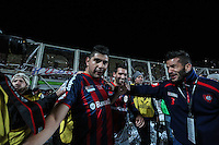 BUENOS AIRES, ARGENTINA, 13.08.2014 - COPA LIBERTADORES DA AMÉRICA - Ortigoza do San Lorenzo comemora seu gol durante partida entre San Lorenzo (ARG) e Nacional (PAR) valida pelo jogo de volta da final da Copa Libertadores da America no Estadio Nuevo Gasometro em Buenos Aires na Argentina na noite desta quarta-feira, 13. (Foto: William Volcov / Brazil Photo Press).