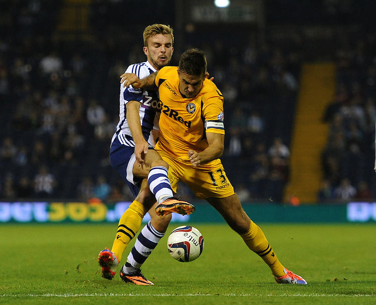 West Bromwich Albion's James Morrison battles with Newport County's Andy Sandell<br /> <br /> Photo by Ashley Crowden/CameraSport<br /> <br /> Football - Capital One Cup Second Round - West Bromwich Albion v Newport County - Tuesday 27th August 2013 - The Hawthorns - West Bromwich<br />  <br /> &copy; CameraSport - 43 Linden Ave. Countesthorpe. Leicester. England. LE8 5PG - Tel: +44 (0) 116 277 4147 - admin@camerasport.com - www.camerasport.com