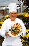Washington: Seattle.  Chef Tim Lords at Chandlers, with crab, model released.  Photo #: wawate104..Photo copyright Lee Foster, www.fostertravel.com, 510/549-2202, lee@fostertravel.com