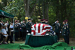 July 3, 2008. Pinetown, NC.. The funeral of Spc. Joel A. Taylor, assigned to the 1st Squadron, 3rd Armored Cavalry Regiment, Fort Hood, Texas; died June 25 in Mosul, Iraq, of wounds sustained when his vehicle encountered an improvised explosive device on June 24, 2008. He was 20.. Military officers and soldiers salute the casket as Spc. Taylor's father, Scottie A. Taylor, far left, looks on..