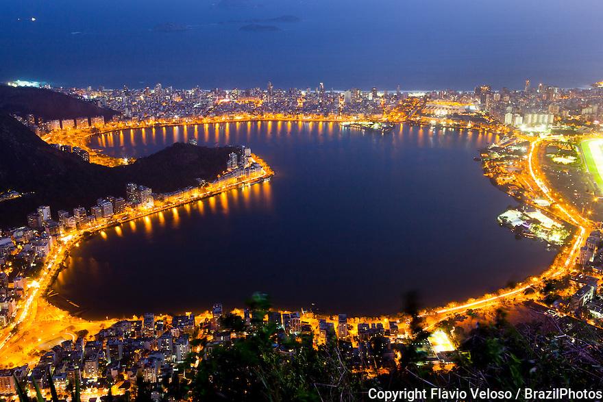 Lagoa Rodrigo de Freitas at night seen from Corcovado mountain, Rio de Janeiro, Brazil.