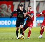Nederland, Enschede, 19 januari 2013.Eredivisie.Seizoen 2012-2013.FC Twente-RKC Waalwijk.Sander Duits (l.) van RKC Waalwijk en Wout Brama (2e van r.) van FC Twente strijden om de bal.