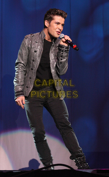 JOE McELDERRY.BRMB Live 2010 at the LG Arena, Birmingham, England..November 27th 2010.full length stage concert live gig performance music singing black grey gray jacket leather jeans denim.CAP/JIL.©Jill Mayhew/Capital Pictures