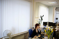 Newspaper editors work at their desks in the offices of Komsomolskaya Pravda in Moscow, Russia.