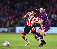 Lincoln City's Bruno Andrade shields the ball from  Carlisle United's Mike Jones<br /> <br /> Photographer Andrew Vaughan/CameraSport<br /> <br /> The Emirates FA Cup Second Round - Lincoln City v Carlisle United - Saturday 1st December 2018 - Sincil Bank - Lincoln<br />  <br /> World Copyright © 2018 CameraSport. All rights reserved. 43 Linden Ave. Countesthorpe. Leicester. England. LE8 5PG - Tel: +44 (0) 116 277 4147 - admin@camerasport.com - www.camerasport.com