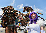 Garden City, New York, USA. 14th June 2015. LAURA GIUNTA, of Levittown, cosplaying as Rarity from My Little Pony, poses holding a chain of The Predator and The Alien sculpture, by artist Hale Storm of Freeport, which was on display outdoors at Eternal Con, the Long Island Comic Con, at the Cradle of Aviation museum. The sculptor created the life-size metal artwork from automotive and motorcycle parts.