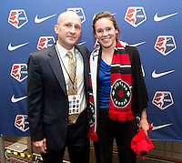 #25 overall pick Emily Menges of Portland Thorns FC stands with head coach Paul Riley during the NWSL draft at the Pennsylvania Convention Center in Philadelphia, PA, on January 17, 2014.