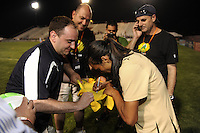 Marta (10) of FC Gold Pride signs autographs after the game. FC Gold Pride defeated Sky Blue FC 1-0 during a Women's Professional Soccer (WPS) match at Yurcak Field in Piscataway, NJ, on May 1, 2010.