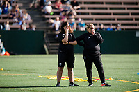Seattle, WA - Sunday, May 21, 2017: Seattle Reign FC head coach Laura Harvey and Tracey Kevins during a regular season National Women's Soccer League (NWSL) match between the Seattle Reign FC and the Orlando Pride at Memorial Stadium.