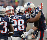 (Foxboro, MA, 01/21/18) New England Patriots running back James White (28) is congratulated by quarterback Tom Brady after White scored against the Jacksonville Jaguars during the second quarter of the AFC championship NFL football game at Gillette Stadium on Sunday, January 21, 2018. Photo by Christopher Evans