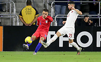 ORLANDO, FL - NOVEMBER 15: Sergino Dest #18 of the United States sends a ball downfield past Jonathan Osorio #21 during a game between Canada and USMNT at Exploria Stadium on November 15, 2019 in Orlando, Florida.
