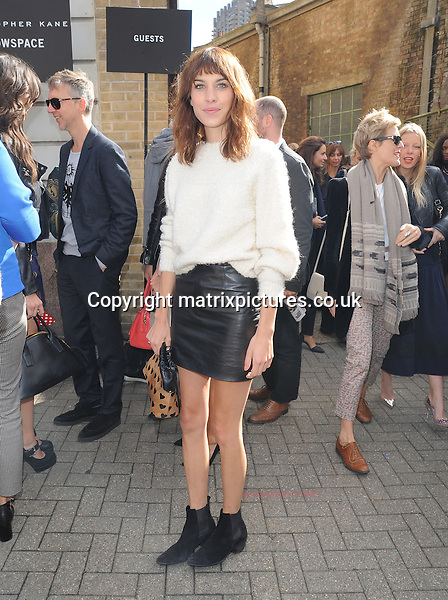 NON EXCLUSIVE PICTURE: PALACE LEE / MATRIXPICTURES.CO.UK<br /> PLEASE CREDIT ALL USES<br /> <br /> WORLD RIGHTS<br /> <br /> English television presenter Alexa Chung attending the Christopher Kane show, during London Fashion Week in London. <br /> <br /> SEPTEMBER 16th 2013<br /> <br /> REF: LTN 136156