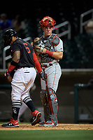 Chattanooga Lookouts catcher Tyler Stephenson (9) looks to the dugout as Yermin Mercedes (6) gets ready to bat during a Southern League game against the Birmingham Barons on May 2, 2019 at Regions Field in Birmingham, Alabama.  Birmingham defeated Chattanooga 4-2.  (Mike Janes/Four Seam Images)