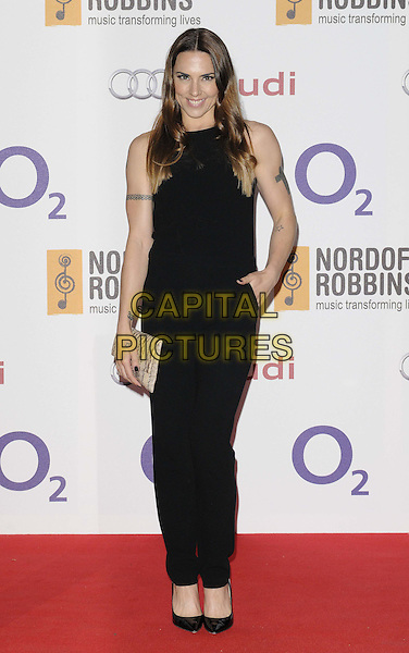 Melanie Chisholm ( Mel C ).The Nordoff Robbins O2 Silver Clef Awards 2012, London Hilton Park Lane Hotel, London, England..June 29th, 2012.full length black jumpsuit beige clutch bag hand in pocket tattoo.CAP/CAN.©Can Nguyen/Capital Pictures.