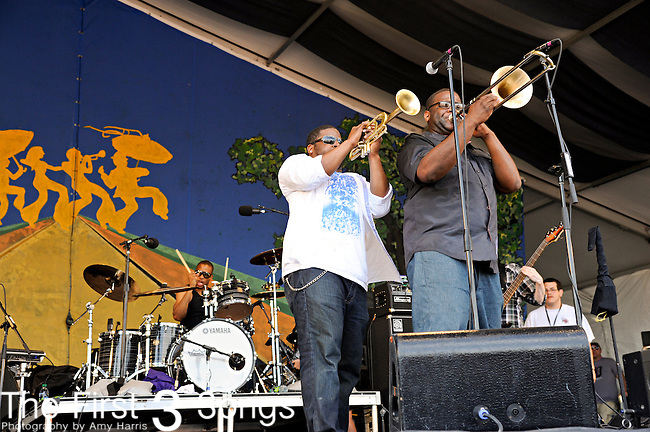 Trombone Shorty (real name Troy Andrews) & Orleans Avenue perform during the New Orleans Jazz & Heritage Festival in New Orleans, LA on May 7, 2011.