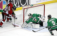 North Dakota goalie Aaron Dell prepares to block a shot by UNO's Jordan Willert during the first period. No. 4 UNO beat No. 7 North Dakota 1-0 Saturday night at Qwest Center Omaha. (Photo by Michelle Bishop)