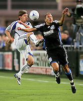 Lance Watson (left) kicks the ball against Darren Huckerby (right). The San Jose Earthquakes defeated the Kansas City Wizards in stoppage time 1-0 at Buck Shaw Stadium in Santa Clara, California on August 22, 2009.
