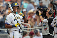 Michigan Wolverines designated hitter Jordan Nwogu (42) laughs for the ESPN camera before playing against the Texas Tech Red Raiders during the first game of the NCAA College World Series on June 15, 2019 at TD Ameritrade Park in Omaha, Nebraska. Michigan defeated Texas Tech 5-3. (Andrew Woolley/Four Seam Images)