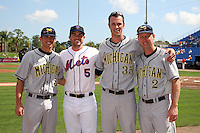 Anthony Toth #5, David Wright #5, Kolby Wood #35 and Rich Maloney #2 pose for a photo before a Michigan Wolverines vs the New York Mets exhibition game at Digital Domain Ballpark in Port St Lucie, Florida;  February 27, 2011.  New York defeated Michigan 7-1.  Photo By Mike Janes/Four Seam Images