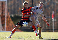 WASHINGTON, DC - NOVEMBER 25, 2012: Joey Dillon (4) of Georgetown University goes for the ball wirh Louis Clark (7) of Syracuse University during an NCAA championship third round match at North Kehoe field, in Georgetown, Washington DC on November 25. Georgetown won 2-1 after overtime and penalty kicks.