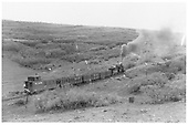 Locomotive, 3 gondolas with coal loads, and long caboose west of Cimmaron.<br /> D&amp;RGW  w. of Cimarron, CO