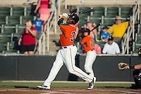 K.J. Woods (32) of the Greensboro Grasshoppers follows through on his swing against the Kannapolis Intimidators at CMC-Northeast Stadium on June 11, 2015 in Kannapolis, North Carolina.  The Intimidators defeated the Grasshoppers 7-6.  (Brian Westerholt/Four Seam Images)