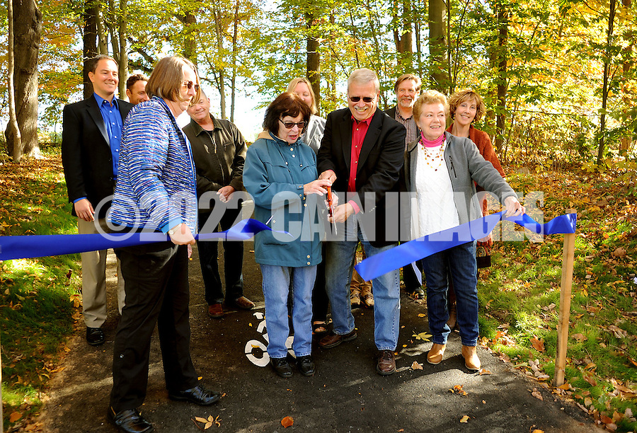 Chalfont Mayor Marilyn Becker (front row, 2nd from left) and New Britain Borough Mayor David Holewinski (front row 2nd from right) cut the ribbon at the dedication and ribbon cutting for the new Blue Jay Trail Friday October 23, 2015 in New Britain, Pennsylvania. (Photo by William Thomas Cain)  Republican Party: