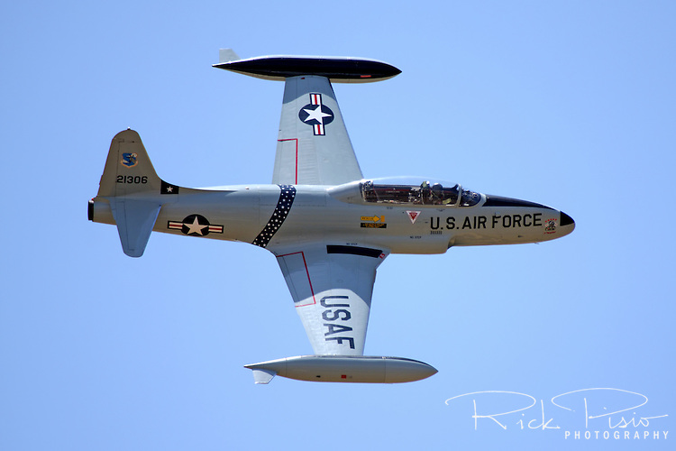 Lockheed T-33 Shooting Star in Flight at the 2009 Madera Air Show in Madera, California. The Lockheed T-33 Shooting Star was developed from the P-80/F-80 fighter and made its first flight in 1948.