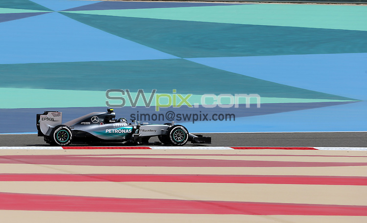 PICTURE BY MARK GREEN/SWPIX.COM - Formula 1, Bahrain International Circuit, 17-19th April 2015 <br /> Lewis Hamilton in his Mercedes on the most colourful part of the citcuit in Bahrain