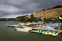 Rental boats are ready and waiting, but remain moored as rolling storms pass over the marina at Lake Chabot Regional Park. California.