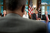 Secretary of Health and Human Services Kathleen Sebelius (L), UNited States Secretary of State Hillary Rodham Clinton (2L) and U.S. Secretary of Defense Robert M. Gates (R) listen as U.S. President Barack Obama speaks to the press after a meeting in the Cabinet Room of the White House June 22, 2010 in Washington DC.  President Obama spoke about the war on terrorism, the Gulf of Mexico Oil spill and Gen. Stanley A. McChrystal's comments about the administration in a Rolling Stone..Credit: Brendan Smialowski - Pool via CNP