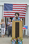 Wantagh, New York, USA. July 4, 2015. ADAM EZEGELIAN, American Idol Season 14 finalist and Wantagh resident, sings at podium at start of The Miss Wantagh Pageant ceremony, and ELLA STEVENS, at extreme left, is the coordinator of the long-time Independence Day tradition on Long Island, which is held at Wantagh School after the town's July 4th Parade.