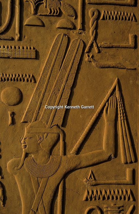 Detail of relief from Senusret I White Chapel at Karnak, Middle Kingdom; Depicts Horus leading Senusret before god Amun-Min; 18th dynasty builders used temple block in pylon for Akhenaten's Temple of Amun