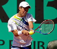 Kei Nishikori (JPN) against Santiago Giraldo (COL) in the first round of the men's singles. Kei Nishikori beat Santiago Giraldo 2-6 4-6 7-6 6-2 6-4..Tennis - French Open - Day 2 - Mon 24 May 2010 - Roland Garros - Paris - France..© FREY - AMN Images, 1st Floor, Barry House, 20-22 Worple Road, London. SW19 4DH - Tel: +44 (0) 208 947 0117 - contact@advantagemedianet.com - www.photoshelter.com/c/amnimages