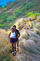 Couple hiking Lanikai ridge trail on Oahu's windward side